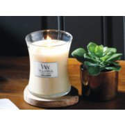 vanilla bean medium hourglass candle on table image number 2