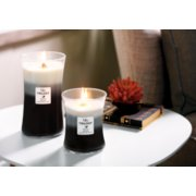 fireside and redwood and sandalwood clove large hourglass trilogy candle on table image number 3