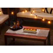 green mandarin citronella outdoor candle on table image number 1