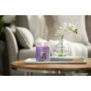 lilac blossoms purple candles on tray with books image number 2