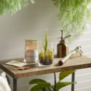outdoor yard setting with large planter on table image number 4