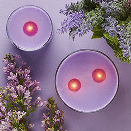 candle with decorative purple flowers