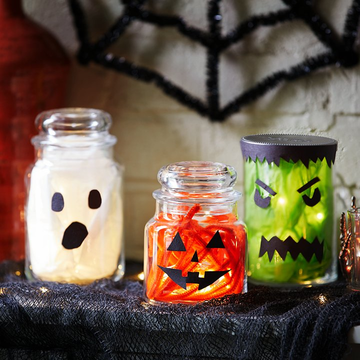 halloween decorations made out of candle jars