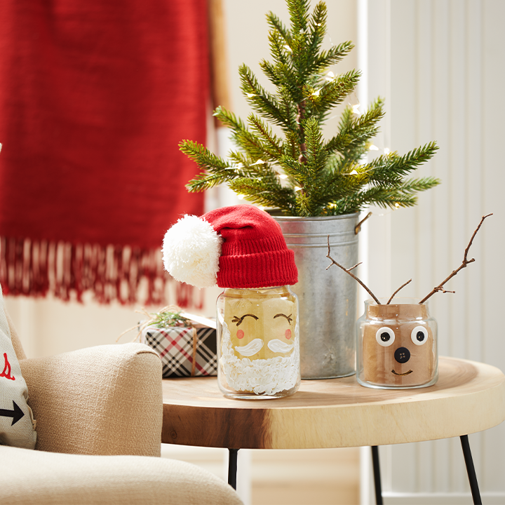 holiday themed glass jars on table