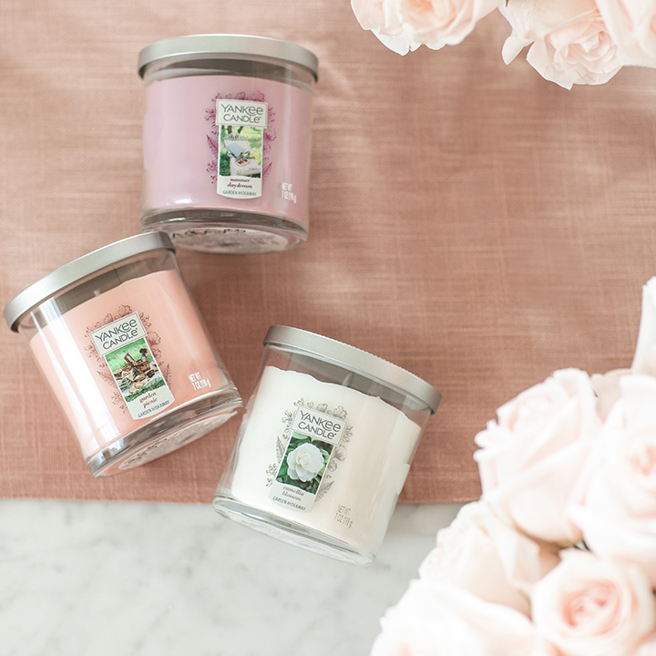 pink and white small tumbler candles with roses